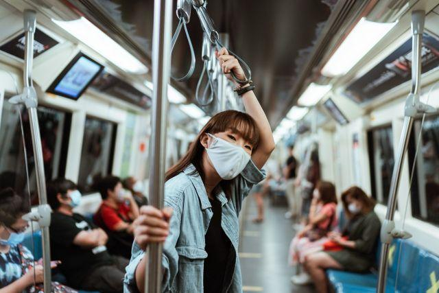 Woman in face mask on subway. Photo by Ketut Subiyanto/Pexels